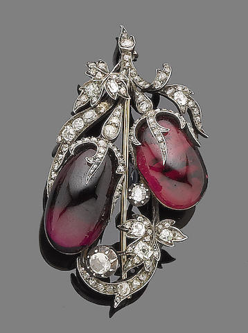 A garnet and diamond brooch,