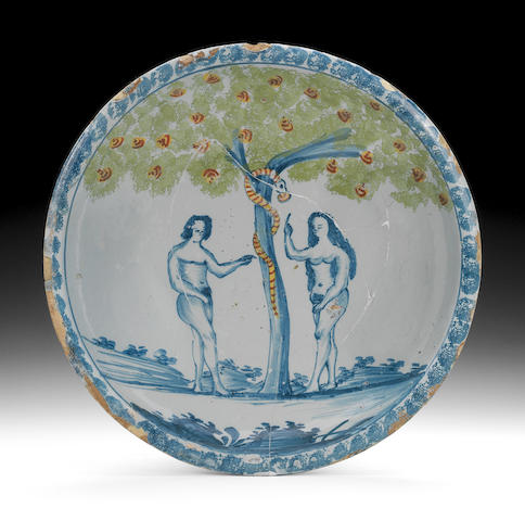 A Bristol delftware Adam and Eve charger, circa