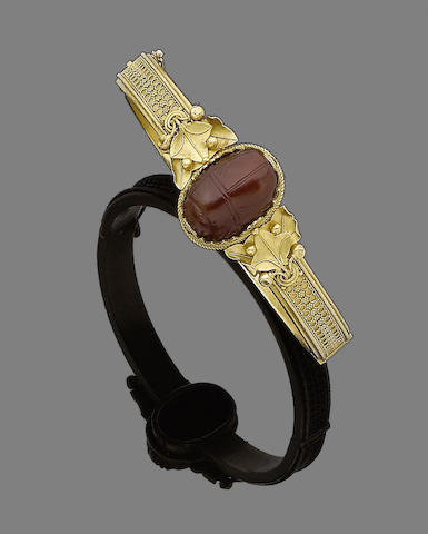 A gold and cornelian archaeological revival hinged bangle, by Melillo,