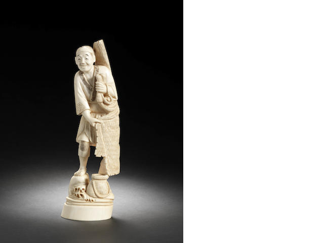 An ivory figure of a fisherman By Tomoyuki, Meiji Period