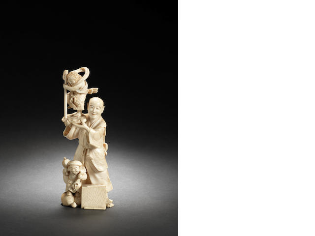 An ivory figure of a sculptor By Kogetsu, Meiji Period