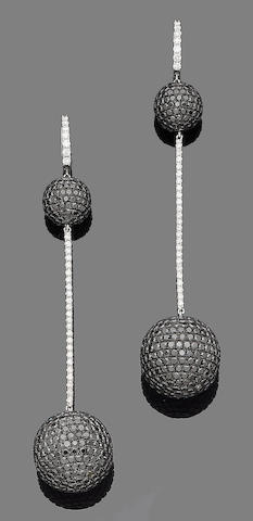 A pair of black diamond and diamond pendent earrings