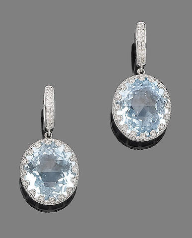 A pair of topaz and diamond earrings