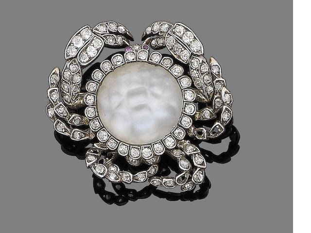 A moonstone, ruby and diamond brooch,