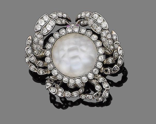 A moonstone, ruby and diamond brooch,
