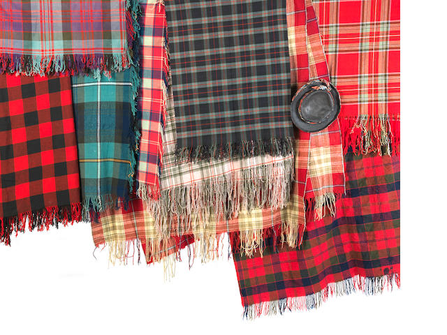 A large Balmoral tartan shawl and eight further shawls