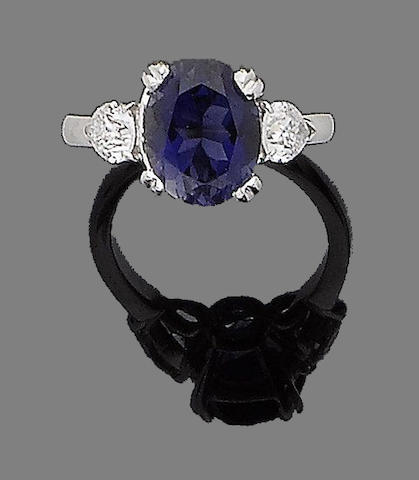 An iolite and diamond ring