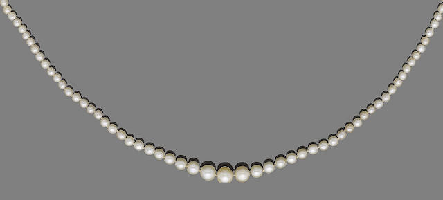 A single-strand natural pearl necklace with diamond plaque clasp