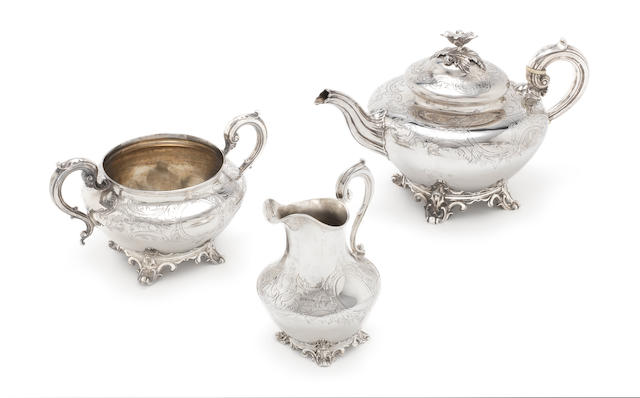 A matched Victorian silver three-piece silver tea service the teapot by The Barnards, London 1841, the sugar and cream, by Edward Ker Reid, London 1863  (3)