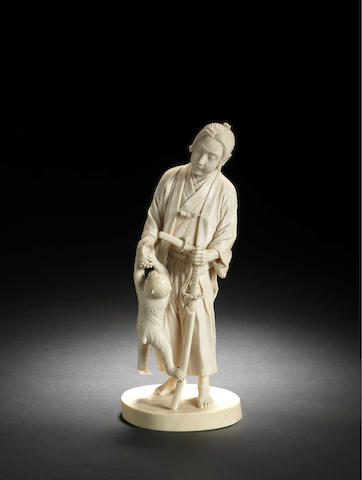 A Tokyo School ivory figure of a young Samurai By Masakage, Meiji Period