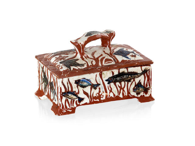 A Harvey School glazed earthenware rectangular box and cover