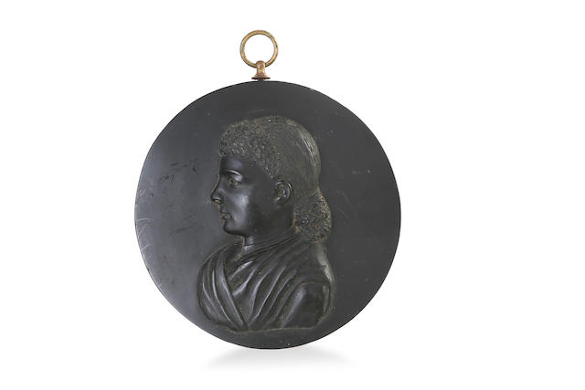 A late Victorian Kerosene shale portrait medallion, titled Acness 1884 by John Baird (1834-1894)