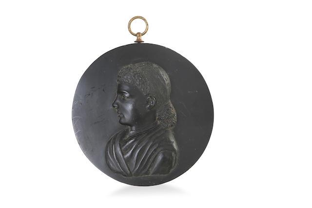 A Victorian Kerosene shale portrait medallion, titled Acness 1884