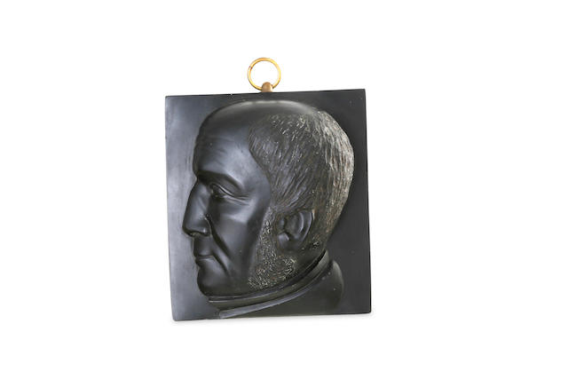 A late Victorian  Kerosene shale portrait medallion titled WE Gladstone, 1884 by John Baird (1834-1894)