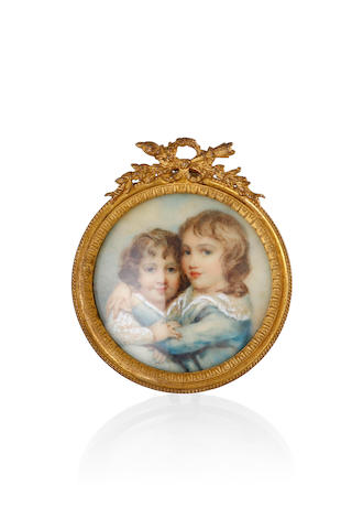 A Georgian miniature on ivory of a young boy embracing a young girl