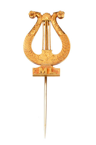 An Australian gold Lyne stick pin by William Drummond & Co Collins Street Melbourne, circa 1890, the finely chased lyne with flower ferns and initials ML,