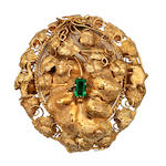 An Australian gold locket brooch, circa 1880, with a green rectangular paste set on a hinged vine leaf openning to reveal a photograph print of a bearded gentleman,
