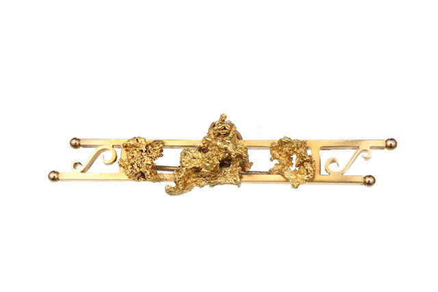 An Australian gold nugget bar brooch by Stevenson Brothers, Rundle Street, Adelaide circa 1885