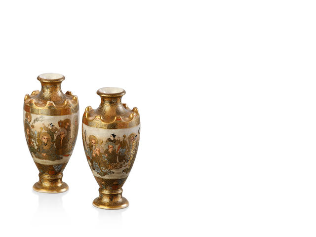 A pair of small Satsuma vases with crenulated designs to top.