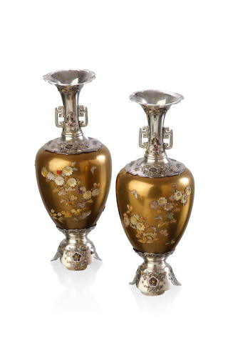 A fine pair of shibayama vases; with a glass display case