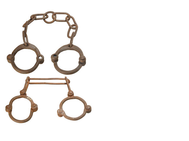 Two sets of standard convict rivet leg irons