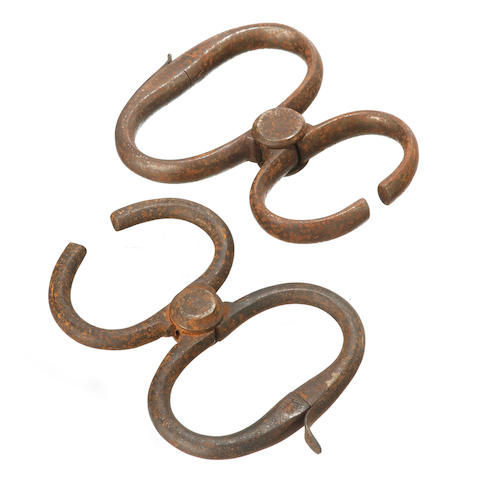 Two similar convict handcuffs, both stamped 'Hiatt' and one stamped 'British Made',