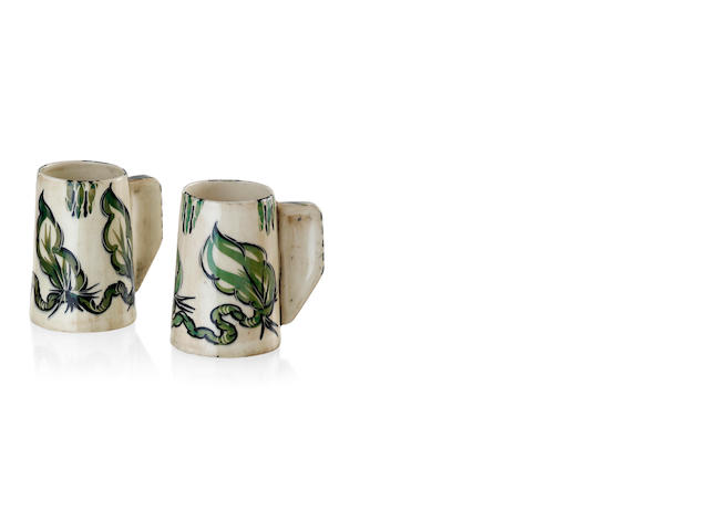 A pair of glazed earthenware mugs by Byram Mansell
