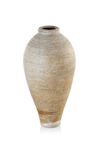 A slender salt glazed earthenware vase by Stephen Harrison