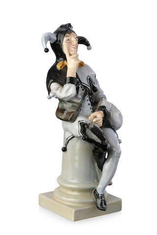 'A Jester' a Royal Doulton titled figure, designed by Charles Noke