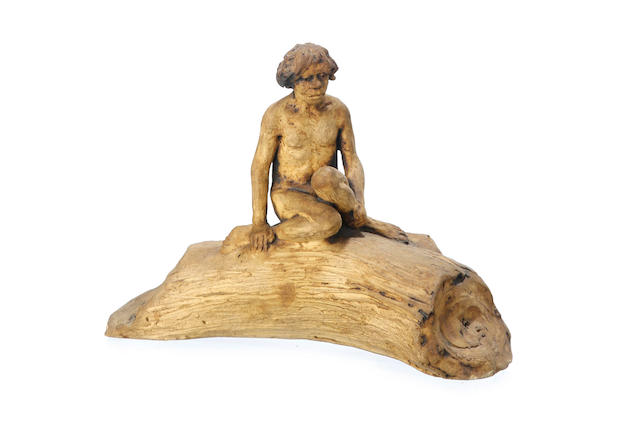 An earthenware figure of a young indigenous man seated on a tree trunk by William Ricketts (1898-1993)