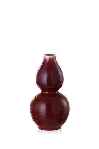 A Chinese Sang de Boeuf double gourde vase, Jingdezhen zhi seal mark, 19th century