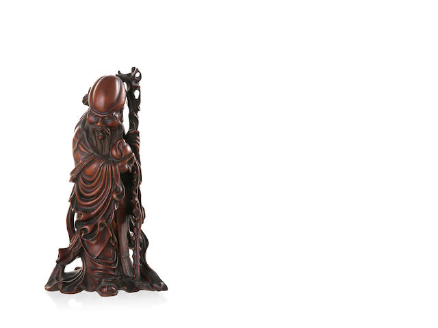 A 19th century Chinese wood carving of the deity Shou