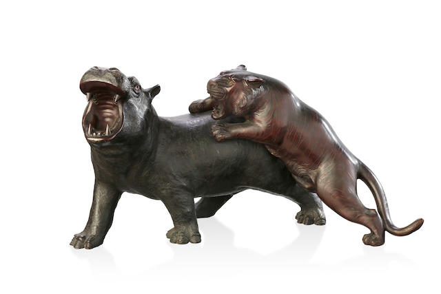 A Japanese bronze figure group of a tiger attacking a hippopotamus, Meiji Period