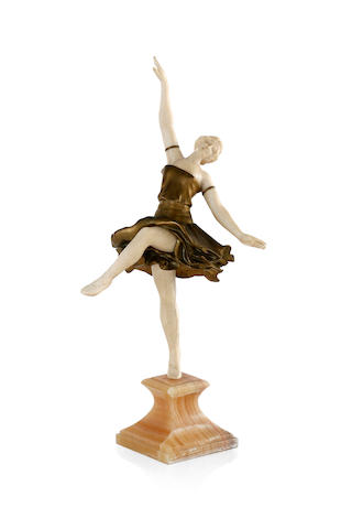 L. Sosson An Art Nouveau bronze and ivory figure of a dancer with out-stretched ivory arms
