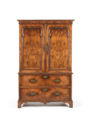 A George I burr walnut and line inlaid press cupboard