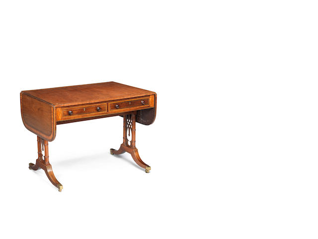 A Regency rosewood and satinwood banded sofa table with pierced trellis end supports