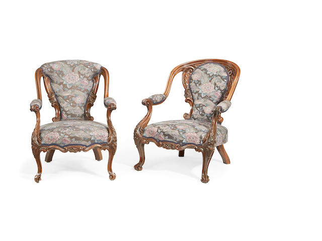 A pair of mid Victorian rosewood low armchairs in the Louis XV revival style