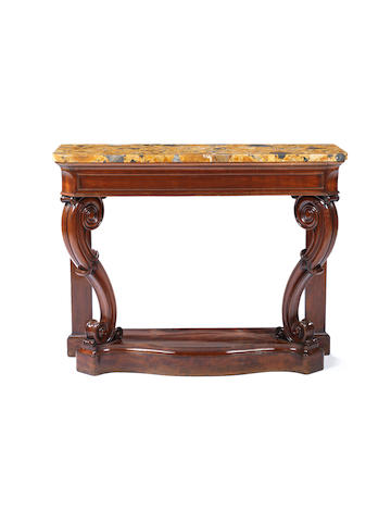A George IV carved mahogany console table