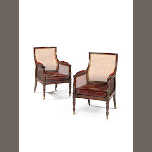 A pair of Regency mahogany library bergeres by Gillows of Lancaster