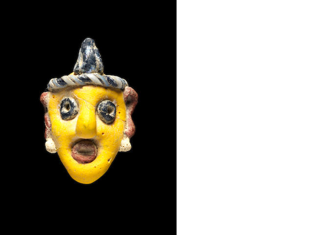 A Phoenician polychrome glass head
