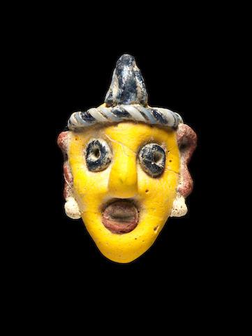 A Phoenician polychrome glass head