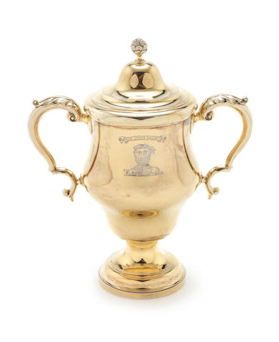 An Edwardian silver-gilt two-handled cup and cover by Carrington & Co, London 1901