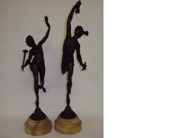 A pair of 19th century bronze figures on marble plinths