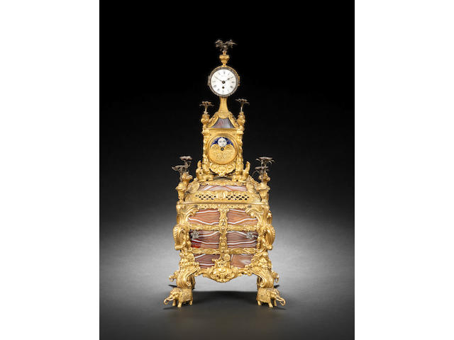 James Cox; a fine ormolu, agate-set table clock with moonphase and musical base (currently inoperative) together with the original signed and dated key, 'Jas Cox 1766' (one finial loose and one missing)