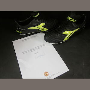 A pair of Phil Neville's hand signed football boots