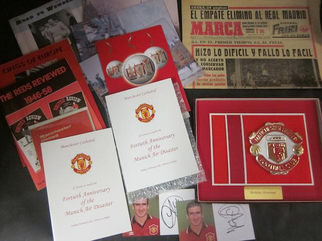 A collection of Manchester United items including 1999 team signatures