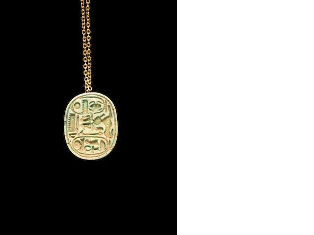 An Egyptian glazed steatite oval plaque
