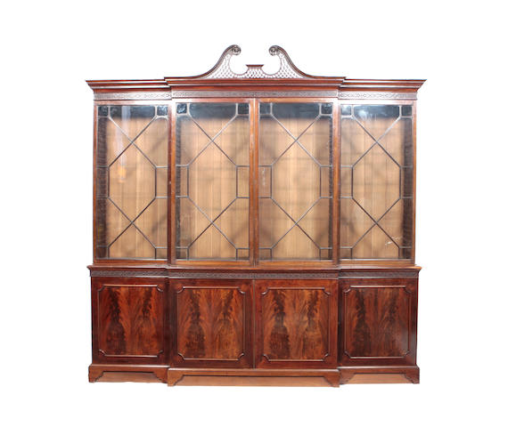 A late 19th century mahogany breakfront book case Of George III design