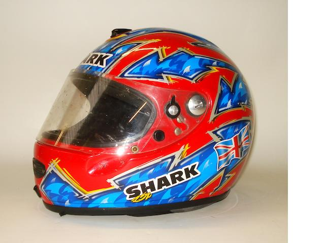 A replica 1998 Season Carl Fogarty motorcycle helmet, by Shark,