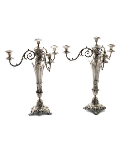 A pair of late Victorian electroplated four-light candelabra with plate marks